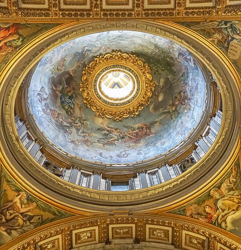 VATICAN CITY, ITALY: OCTOBER 11, 2017: Interior Ceiling of St. Peter`s Basilica Papal Basilica of St Peter The world`s largest church and center of stock photo