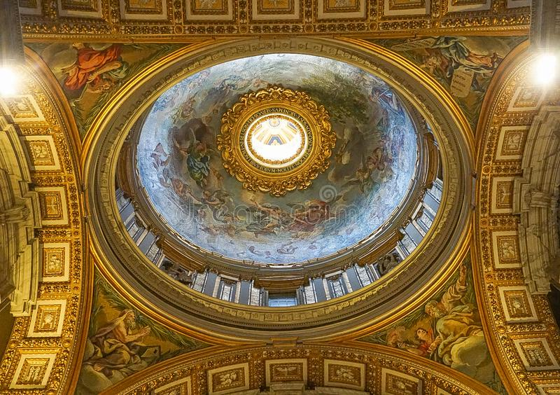 VATICAN CITY, ITALY: OCTOBER 11, 2017: Interior Ceiling of St. Peter`s Basilica Papal Basilica of St Peter The world`s largest church and center of stock images