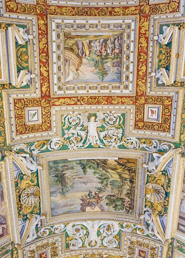 VATICAN CITY, ITALY: OCTOBER 11, 2017: Paintings on the ceilin. Gs in the Gallery of Maps hall in the Vatican Museum stock photo