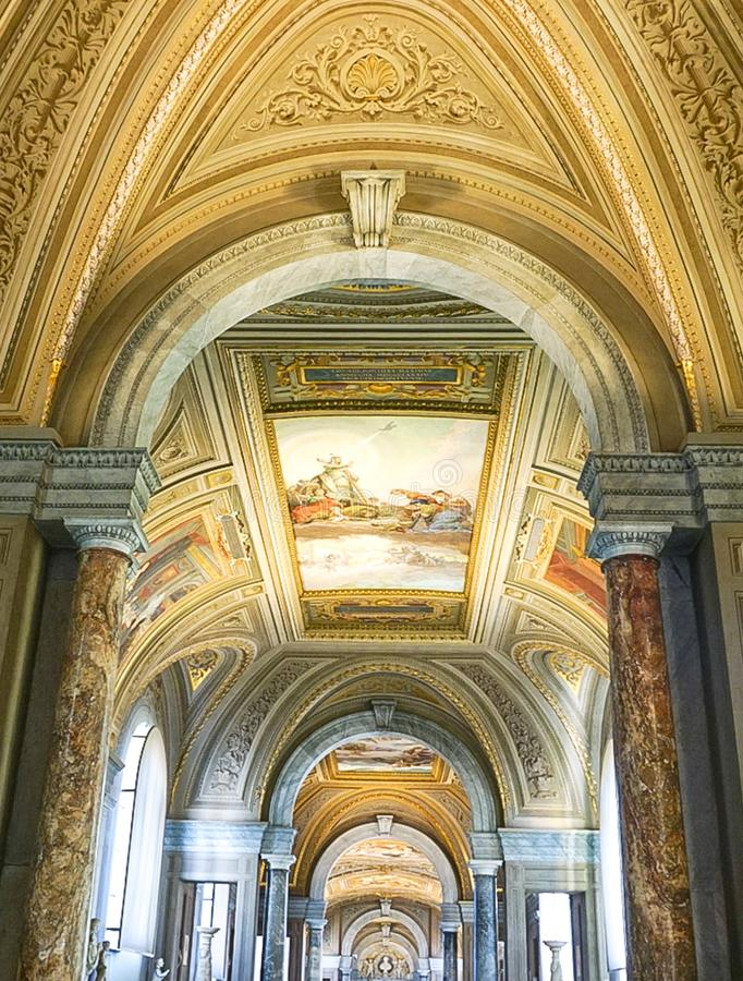 VATICAN CITY, ITALY: OCTOBER 11, 2017: Paintings on the ceilin. Gs in the hall of the Vatican Museum royalty free stock photography