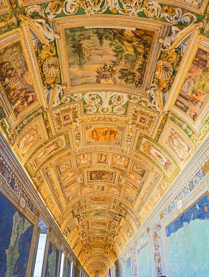 VATICAN CITY, ITALY: OCTOBER 11, 2017: Paintings on the walls. And ceilings in the Gallery of Maps hall in the Vatican Museum royalty free stock image