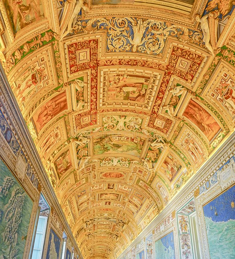 VATICAN CITY, ITALY: OCTOBER 11, 2017: Paintings on the walls. And ceilings in the Gallery of Maps hall in the Vatican Museum stock image