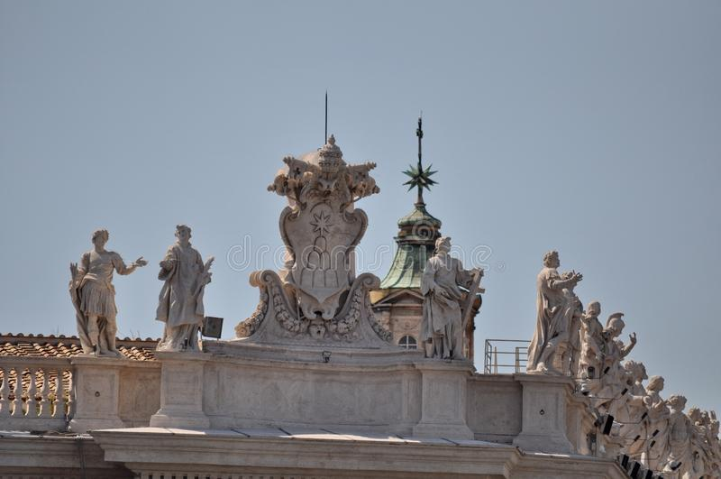 Statues carved by Michelangelo on the top of Saint Peter`s Basilica facade, Rome. Vatican, Vatican City, Italy, September 12, 2015: Statues carved by stock photography