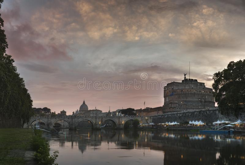 Vatican City, Rome, Italy, Beautiful Vibrant Night image Panorama of St. Peter`s Basilica. Ponte St. Angelo and Tiber River at Dusk in Summer. Reflection of royalty free stock photography