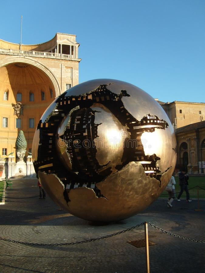 Vatican City, Rome / Italy - November 01, 2019: a golden metal ball representing the broken planet Earth. The insides of the stock photo