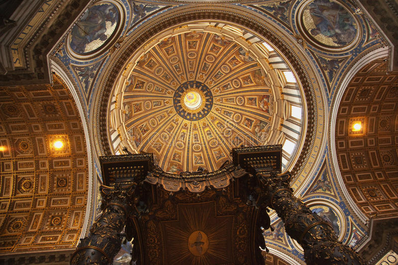 Vatican Inside Looking UpMichelangelo's Dome. Saint Peter's Basilica Vatican Inside From Bernini's bronze baldacchino Looking Up to Michelangelo's Dome and stock images