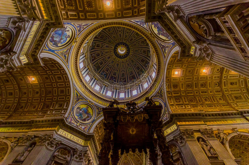 VATICAN, ITALY - JUNE 13, 2015: Dome and Baldacchino at St. Peter's Basilica in Vatican, beautiful structure and. Architecture royalty free stock photography