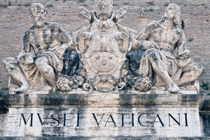 Vatican Museum. Statues above the entrance to the Vatican Museum royalty free stock photography