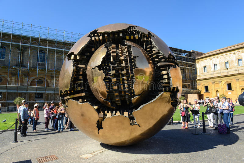 Vatican Museum. VATICAN - OCTOBER 18: People around Sphere in Courtyard of the Pinecone at Vatican Museums at October 18, 2014. Sphere was created in 1990 by royalty free stock image