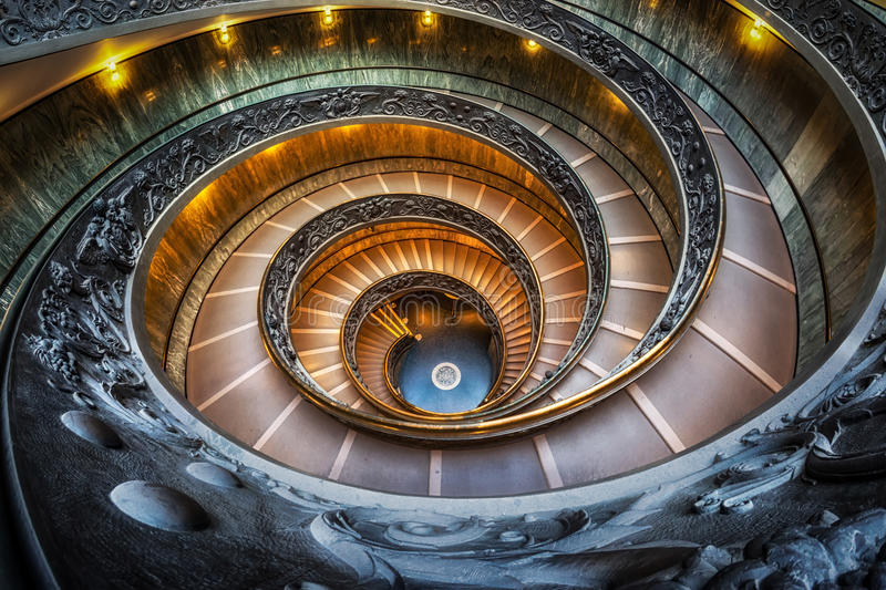 Vatican Museum Stairs. Vatican museum spiral staircase taken with fisheyes lens. Taken in Vatican, Italy royalty free stock image