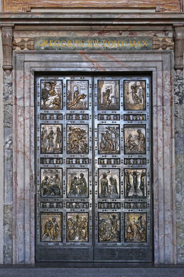 Holy Door in Vatican. Vatican - October 26, 2009: The Holy Door at Saint Peter Cathedral in Vatican City royalty free stock images