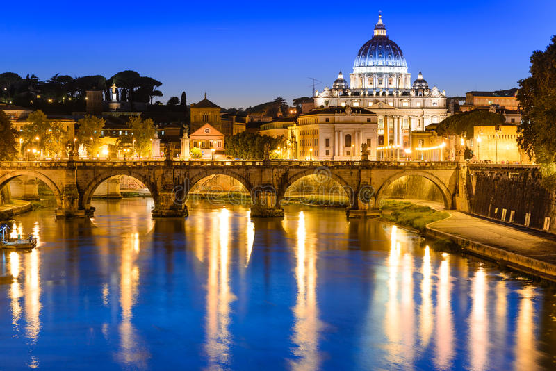 Vatican, Rome. Rome, Italy. Night image of Vatican, dome of San Pietro and Sant Angelo Bridge, over Tiber river stock photos