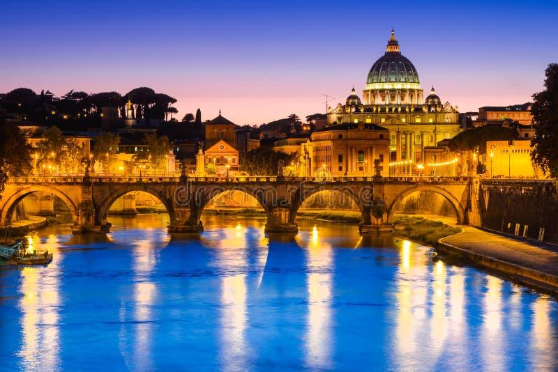 Vatican, Rome, Italy. Rome, Italy. Night image of Vatican, dome of San Pietro and Sant Angelo Bridge, over Tiber river, italian landmark