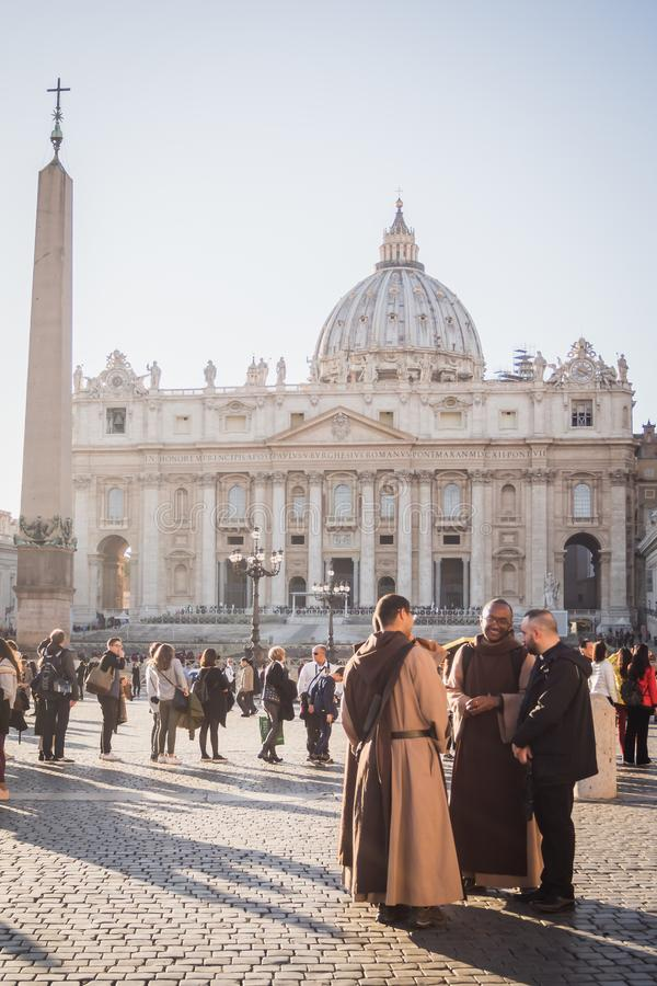 VATICAN, ROME, ITALY - NOVEMBER 17, 2017: Reunion of priests in the middle of the crowd in front of the Vatican on a sunny day stock images