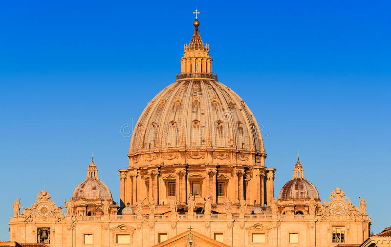 Vatican, Rome, Italy. Sunrise with dome of Saint Peter Basilica from Vatican, main religious Catholic Church, Holy See and Pope residence in Rome. Italy landmark royalty free stock photo