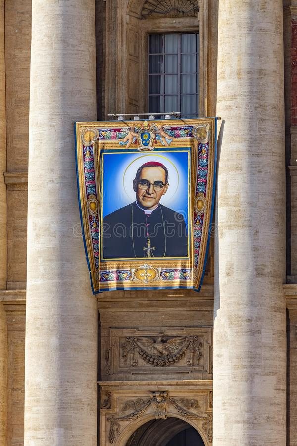 Vatican, St. Peter`s Basilica, the image of Archbishop Oscar Romero. Vatican / Italy - October 14, 2018. Saint Peter`s Square. Tapestry with the image of royalty free stock image