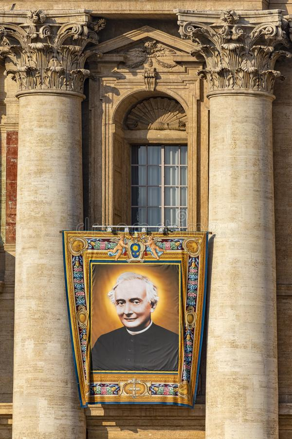 Vatican, St. Peter`s Basilica, the image of Father Francesco Spinelli. Vatican / Italy - October 14, 2018. Saint Peter`s Square. Tapestry with the image of stock images