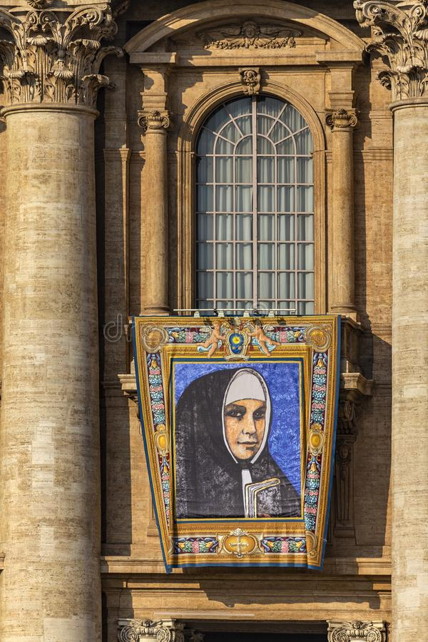 Vatican, St. Peter`s Basilica, the image of Mother Catherine Kasper. Vatican / Italy - October 14, 2018. Saint Peter`s Square. Tapestry with the image of Mother royalty free stock photo