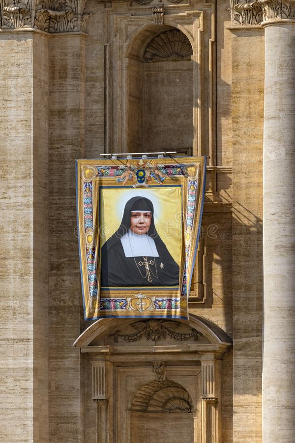 Vatican, St. Peter`s Basilica, the image of Nazaria Ignacia March Mesa. Vatican / Italy - October 14, 2018. Saint Peter`s Square. Tapestry with the image of stock photography