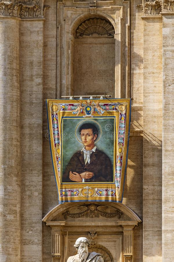 Vatican, St. Peter`s Basilica, the image of Nunzio Sulprizio. Vatican / Italy - October 14, 2018. Saint Peter`s Square. Tapestry with the image of Nunzio royalty free stock images
