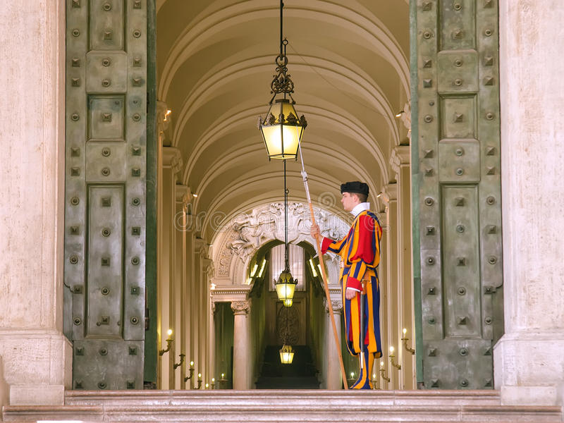 Vatican, swiss guardsman. VATICAN CITY, ITALY - September 2 : Vatican, swiss guardsman stands in front of Vatican Museum on September 2, 2014 in Vatican, Rome royalty free stock images