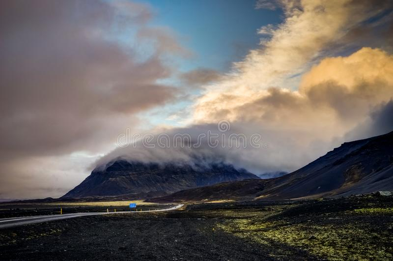 Vatnajokull Glacier covered in fog with mountains and blue sky royalty free stock photography