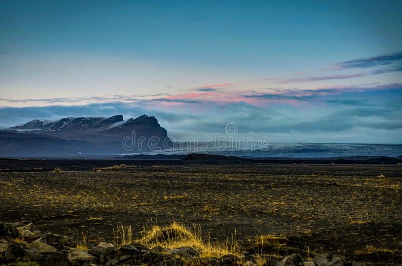 Vatnajokull Glacier covered in fog with mountains and blue sky stock photos