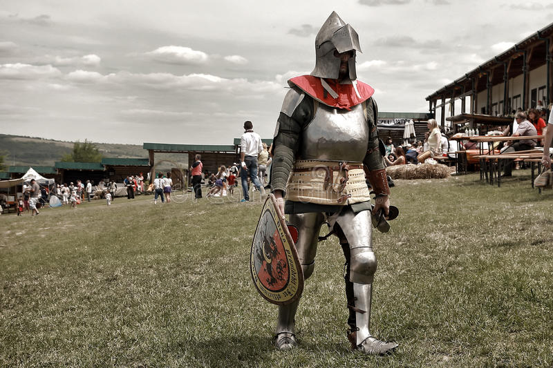 Vatra, Moldova. June 28, 2015. Medieval Festival. Unknown participant in the armor of a medieval knight stock photos