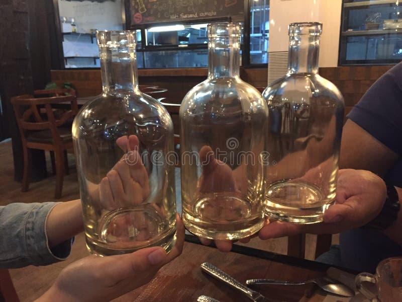 vatten för flaskor tre royaltyfri fotografi