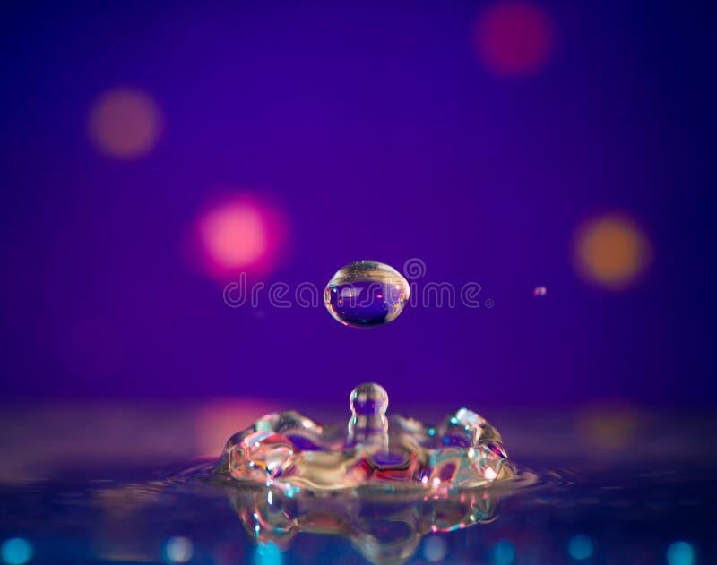 Vattendroppfärgstänk royaltyfri bild