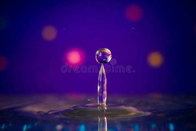 Vattendroppfärgstänk royaltyfri foto