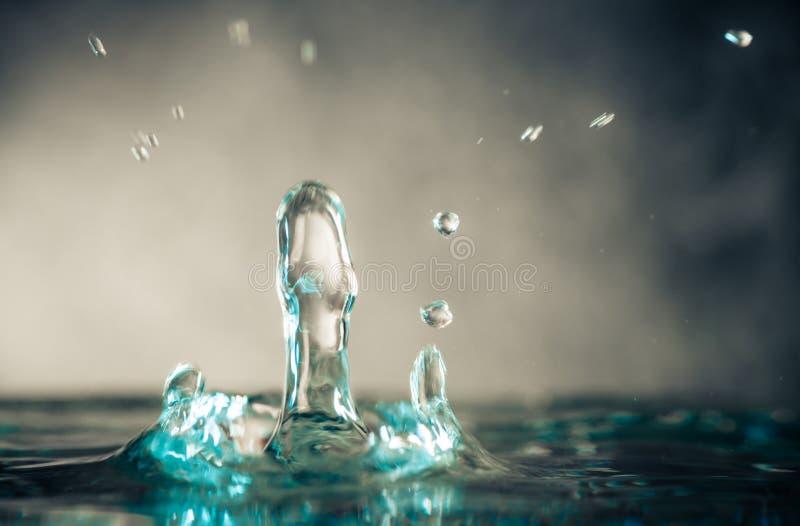 Vattendroppplash fotografering för bildbyråer