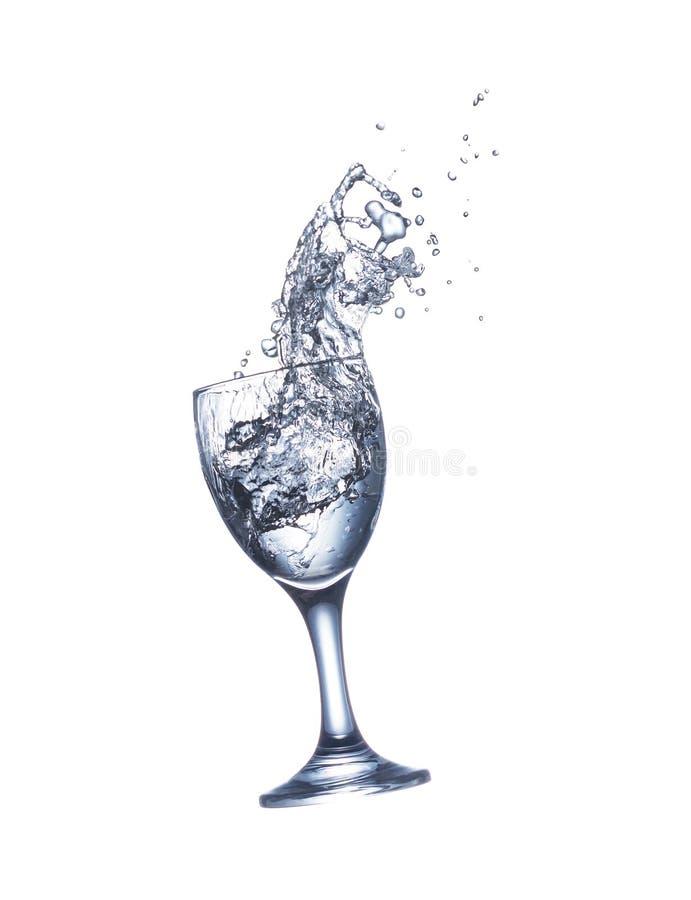 Vattenfärgstänk i exponeringsglas som isoleras på vit bakgrund royaltyfri foto