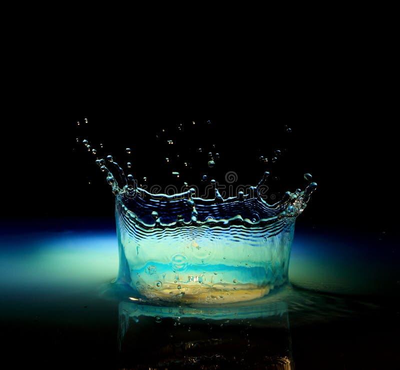 Vattenfärgstänk i svart royaltyfria bilder