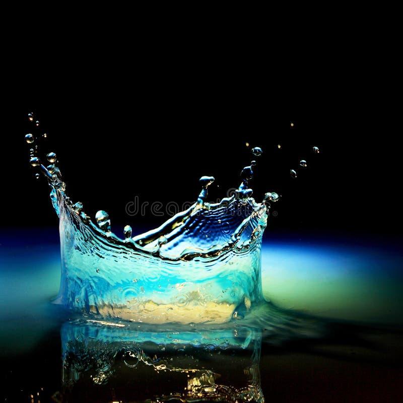 Vattenfärgstänk i svart royaltyfri fotografi