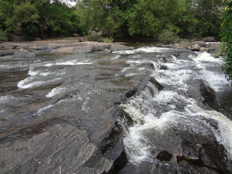 Vattenfall athirapilly royaltyfria bilder