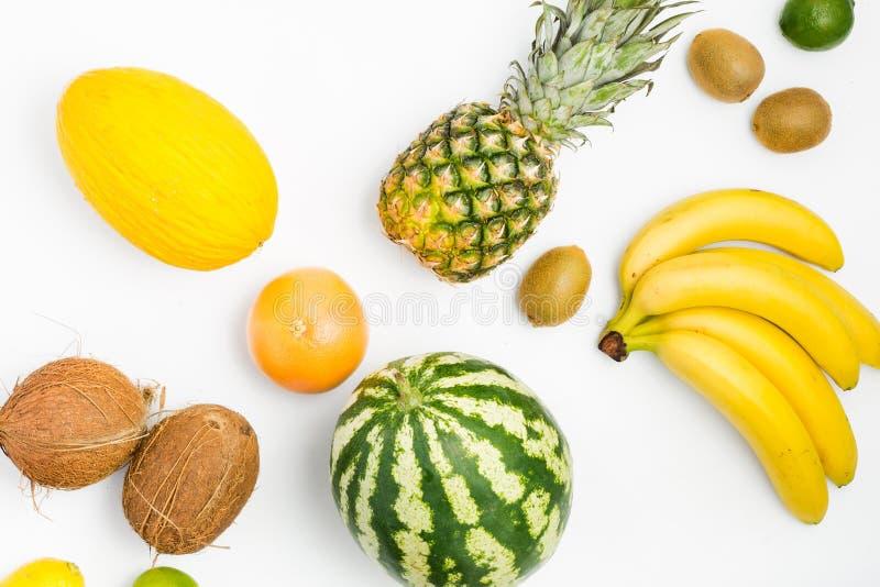 Vattenmelon ananas, grapefrukt, kokosnöt, kiwi, limefrukt, citron, M arkivbild
