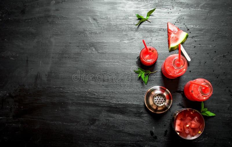Vattenmeloncoctail med mintkaramellen royaltyfri bild