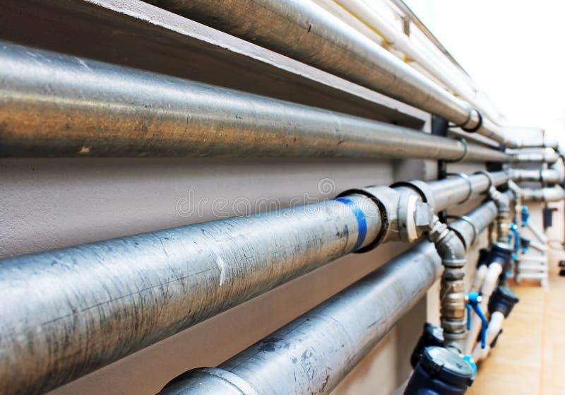 Vattensystem på byggnaden arkivfoton