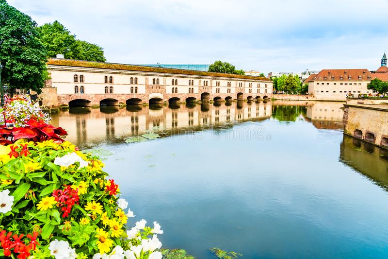 Vauban Dam in Little France quarter in Strasbourg, Alsace region. Strasbourg, France: Vauban Dam Barrage Vauban, a bridge, weir and defensive work erected in the stock images