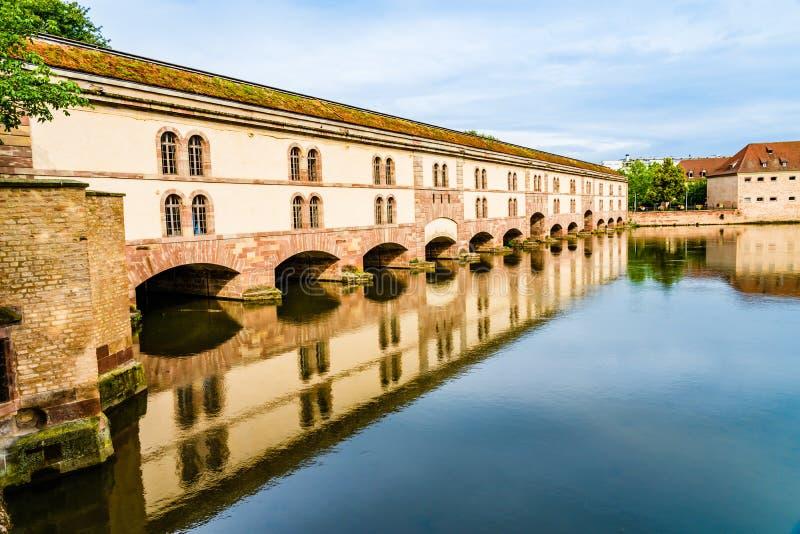 Vauban Dam in Little France quarter in Strasbourg, Alsace region. Strasbourg, France: Vauban Dam Barrage Vauban, a bridge, weir and defensive work erected in the stock photo