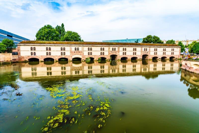 Vauban Dam in Little France quarter in Strasbourg, Alsace region. Strasbourg, France: Vauban Dam Barrage Vauban, a bridge, weir and defensive work erected in the royalty free stock photos