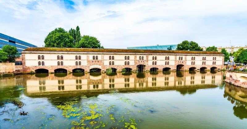 Vauban Dam in Little France quarter in Strasbourg, Alsace region. Strasbourg, France: Vauban Dam Barrage Vauban, a bridge, weir and defensive work erected in the stock photos