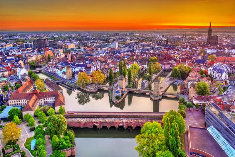 Barrage Vauban, Ponts Couverts and Petite France in Strasbourg. Vauban Dam, Ponts Couverts and historic quarter Petite France in Strasbourg at sunrise stock image