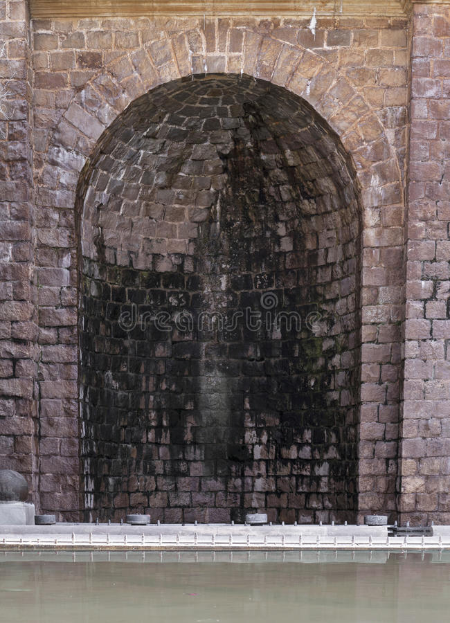 Vaulted alcove. A vaulted alcove made of bricks and water in the foreground royalty free stock photos