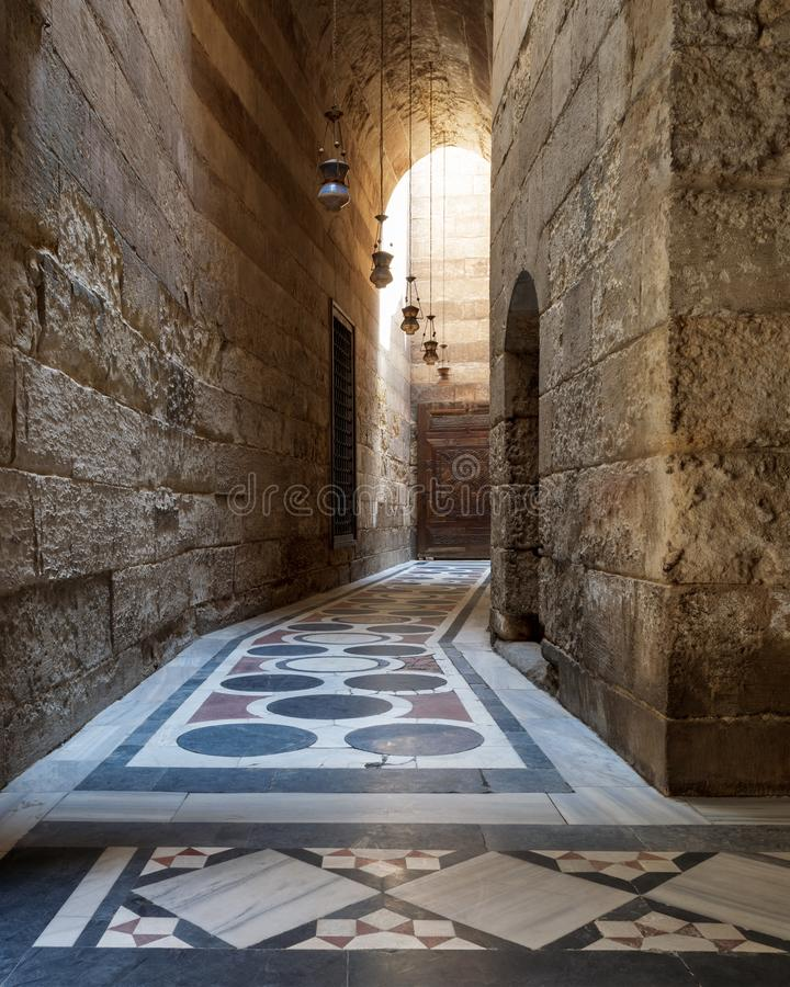 Vaulted passage leading to the Courtyard of Sultan Qalawun mosque with colorful marble floor, Cairo. Vaulted passage leading to the Courtyard of Sultan Qalawun stock image
