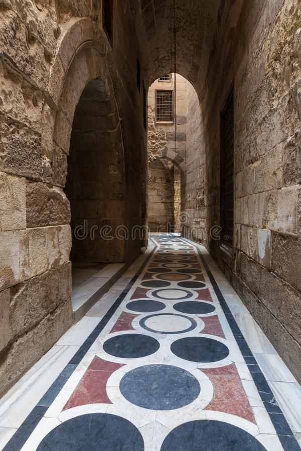 Vaulted passage leading to the Courtyard of Sultan Qalawun mosque with colorful marble floor, Cairo. Vaulted passage leading to the Courtyard of Sultan Qalawun royalty free stock photo