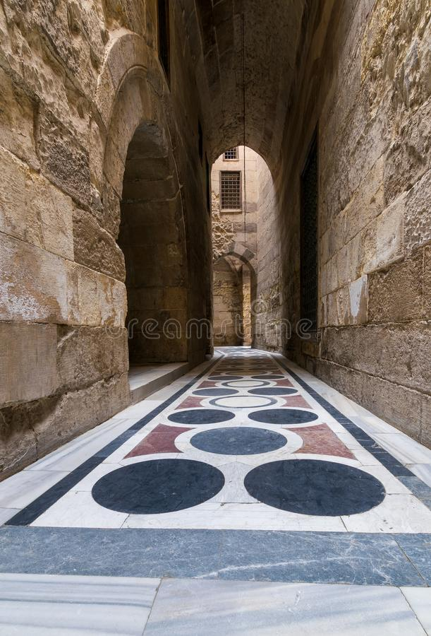 Vaulted passage leading to the Courtyard of Sultan Qalawun mosque with colorful marble floor, Cairo. Vaulted passage leading to the Courtyard of Sultan Qalawun royalty free stock photography