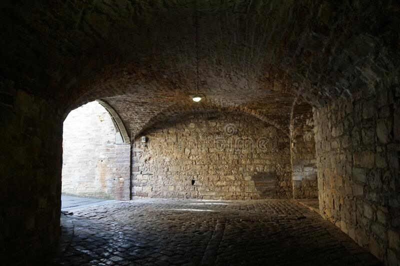 Vaulted underground tunnel or corridors of stone bricks in Hohenzollern Castle Germany royalty free stock photo