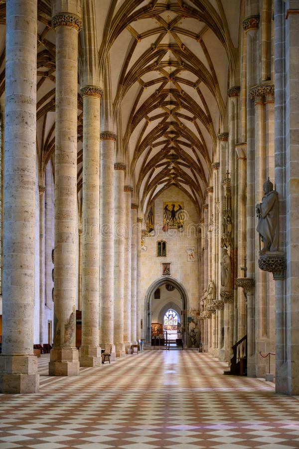 Interior Ulm Minster, side aisle of Ulm Cathedral. Ulm, Baden-Wuerttemberg, Germany royalty free stock images